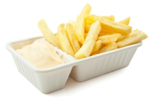 French fries with mayonaise on a white background